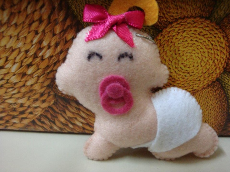 Felt baby...would look great on a gift instead of a bow!