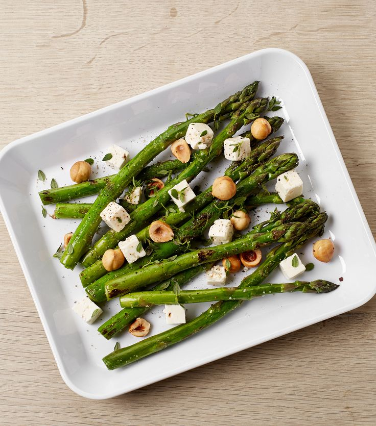Crispy appetizer of green asparagus and white cheese