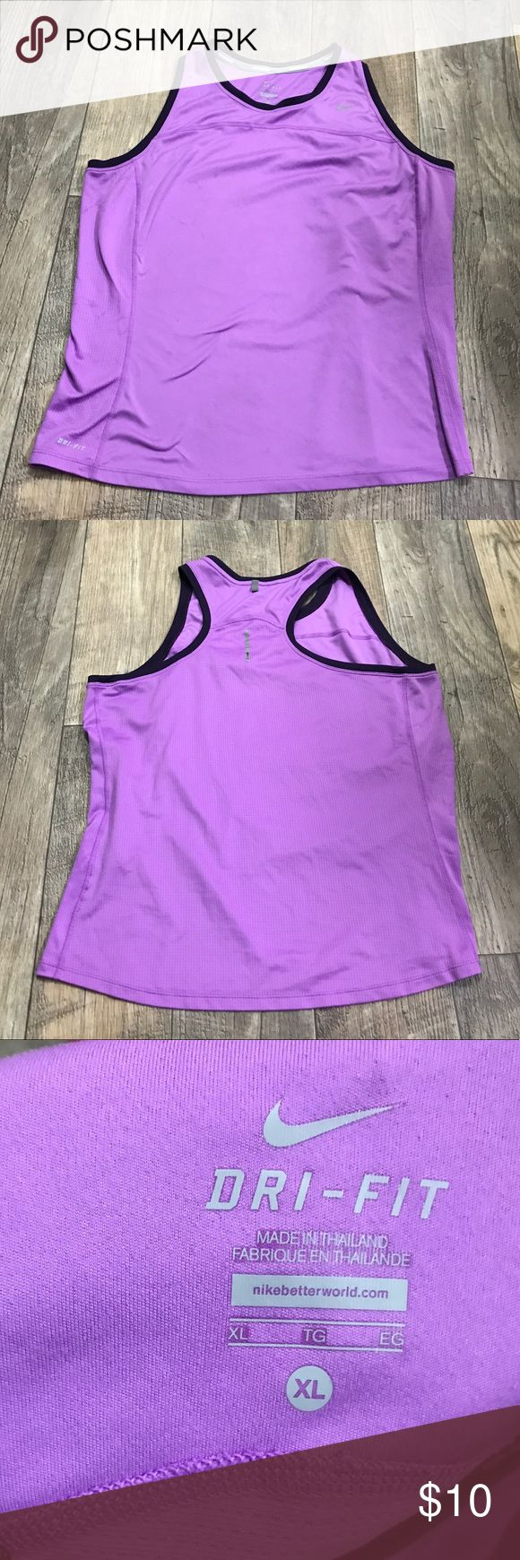 Nike Dri Fit Size XL Purple Fitness Yoga Tank Top This tank top is in great used condition with minimal to no signs of wear. This tank top will look great paired with great workout shorts or capris for warm weather or a great pair of workout pants as well. Either way you choose to pair this tank top it will be a great addition to your exercise/workout/yoga wardrobe. Nike Tops Tank Tops