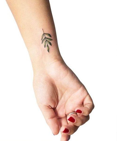 05579945c Pretty Little Fern Leaf Tattoos on Wrist for Girls | Perfect Tattoos |  Branch tattoo, Fern tattoo, Small tattoos