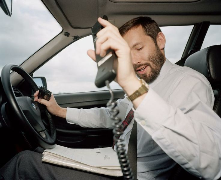 """Martin Parr """"I think people generally assume that if you're in a Sierra or a Cavalier you're a rep racing to get home early for his tea. Whereas if you're driving a BMW you're an important executive on his way to another important meeting"""". 'From A to B. Tales of Modern Motoring', 1994."""