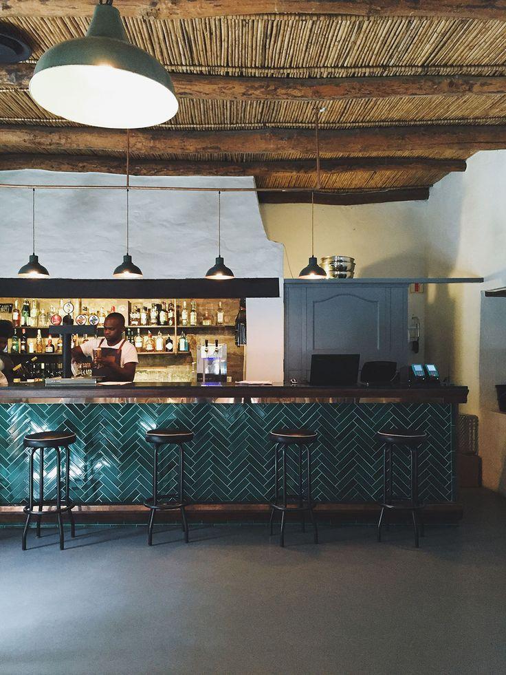 De Warenmarkt, hand glazed herringbone tile on bar.