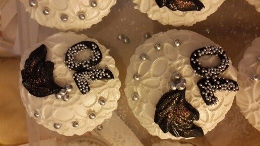 Cupcakes.  Black, white & silver. 70th birthday.