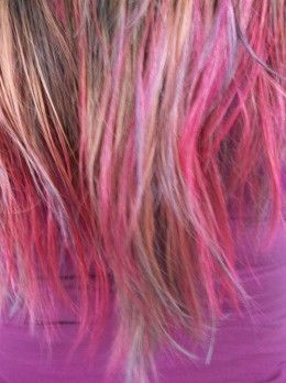Hair is a great way to express yourself. This style has a combination of pink and teal.