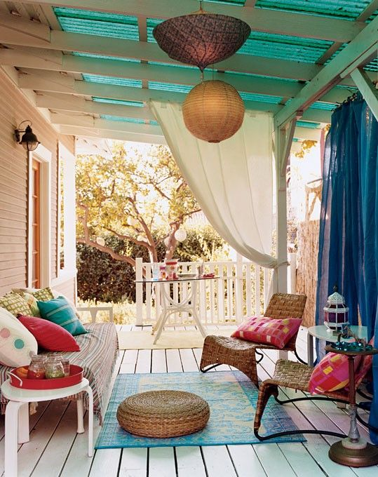 "throw up 4 wood posts; use heavy duty wire to connect and thread fabric or curtains from each one thus creating a ""wall"" around the patio space. Also softens up the area and allows for a more relaxing atmosphere in downtown Columbia."