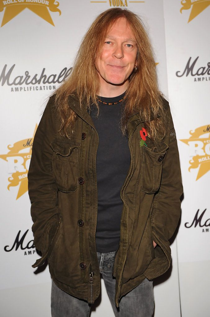 Janick Gers Photos - Nicko McBrain and Janick Gers from the rock group Iron Maiden with their Band of the Year award onstage during the Classic Rock Roll Of Honour Awards at the Park Lane Hotel on November 2, 2009 in London, England. - Classic Rock Roll Of Honour - Show