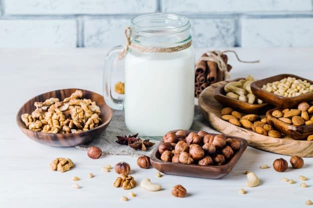 milk and various nuts | Homemade Nut Milk Recipes