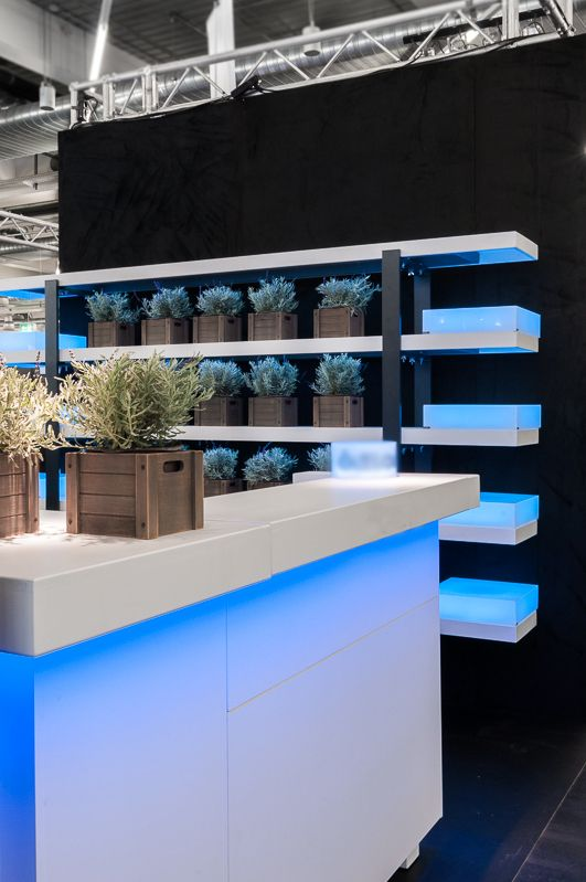 Illuminated bar and lavenders in the background. Forum Vini Munich for Atlas Feinkost. design by Bouquet