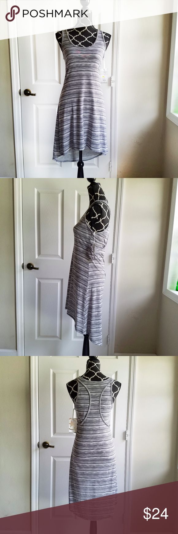 NWT Gray and White Striped Converse Dress New with tags Converse summer dress available, size small with gray and white stripes. It is made of polyester, rayon and spandex and is slightly stretchy and has an asymmetrical hem - shorter in the front, longer in the back.   Laying flay, the bust measures 15 inches and the length is about 32 inches in the front and 38 inches in the back. And it's machine washable and comes from a smoke-free home. :)  I usually ship within one day of sale! :)…