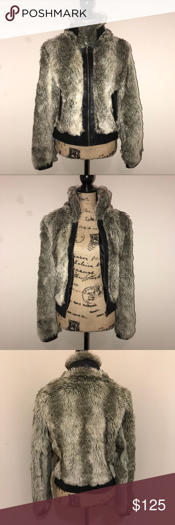 STYLE CANVAS - Soft Vegan Faux Fur Jacket Turn heads this season with a warm, soft, sexy fitted fur jacket. Tapered at the waist and full in the arms. Ostrich embossed leather trim, polyester liner. Great statement piece, especially for holiday parties & New Years. Bought in Germany last year, and very well cared for. Fits 2, 4 and 6 just fine! Style Canvas Jackets & Coats