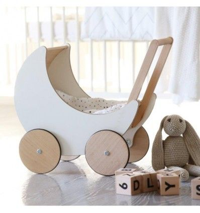 A little wooden pram for all of the favourite dolls. white wooden toy for girls