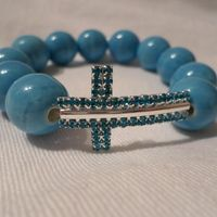 Turquoise Cross made with ceramic beads  Price R150.00  #christian #cross #bracelet #beads #isaacsjewellery
