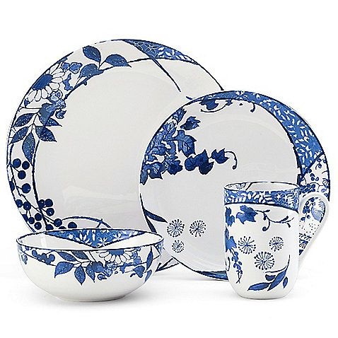 The contemporary Mikasa Hana Dinnerware features a richly colored floral pattern against a crisp white background. Its unique design wraps around each piece of lightly embossed, coupe-shaped porcelain for a fresh style that will brighten your table.