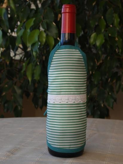 Delantal para botellas hecho de tejido algodón/poliéster y cinta de algodón. Lavable a 30 grados.