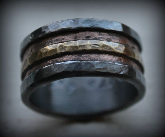 Completely handcrafted / fabricated through metalwork, in Asheville, NC. No mass production is involved. Great attention to detail, love and care is put into each handcrafted ring, making it one-of-a-kind. We love that we are crafting something very special and meaningful for you. All designs are built to last.  Width pictured: 12mm (choose between 8mm-12mm wide at purchase) Thickness: 2.5mm approximately Materials: .999 Fine silver, Copper and Brass *Materials are hand stamped along with…