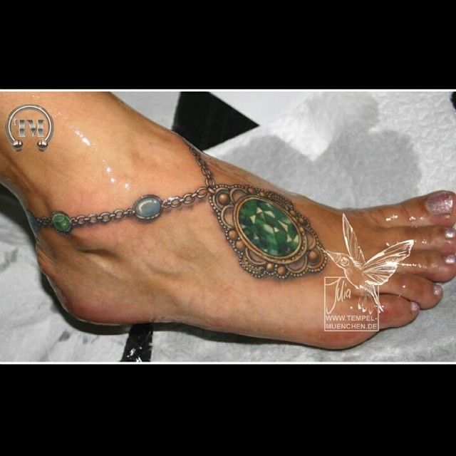 Absolutely gorgeous realistic jeweled anklet foot tattoo with an incredible green gem by Julia