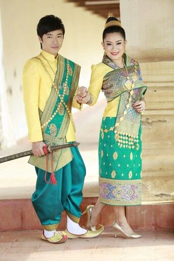 Lao traditional wedding outfit in lime green for bride and groom.
