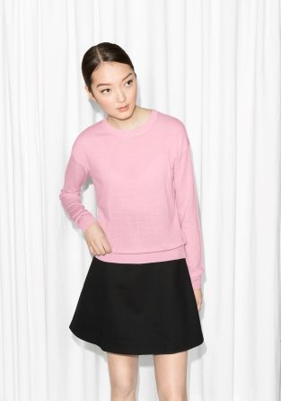 Warming merino wool is crafted into this soft sweater with a classic fit and versatile style.