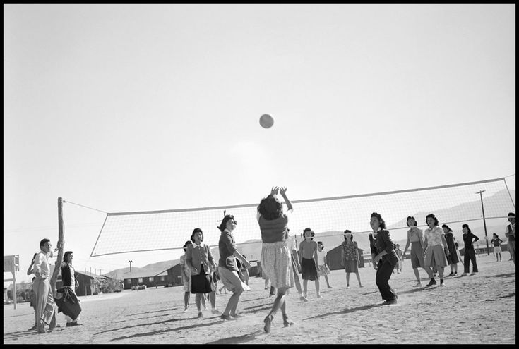 22 Chilling Pictures Of Life At Japanese Internment Camps  - The ladies of camp Manzanar engage in a friendly game of volleyball to pass the time.
