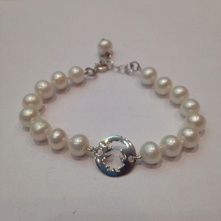 Pulser en perlas y plata para niña