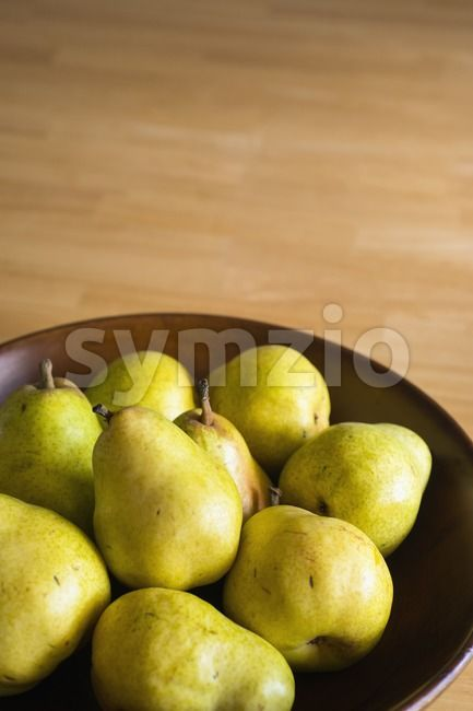 Stock photo of Still life of pears in from $1.99. Pears in a wooden bowl...