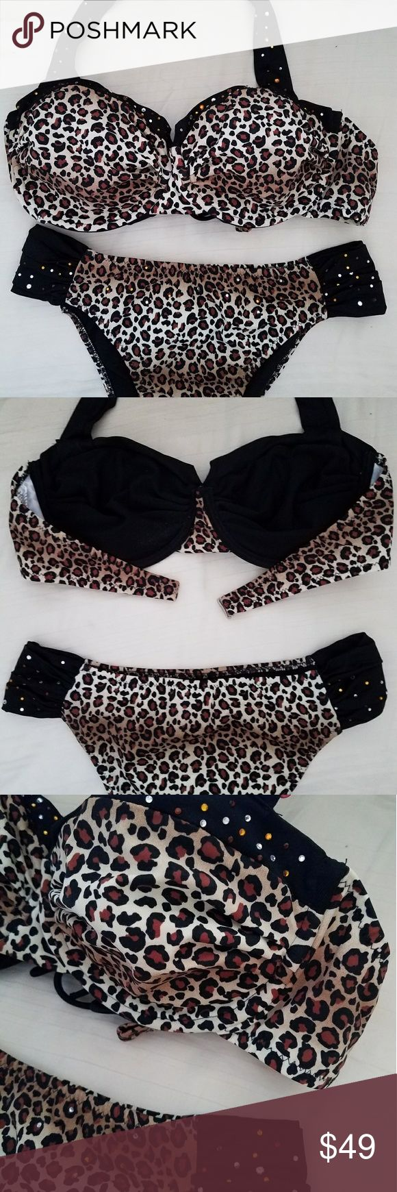 Two piece halter swimsuit with crystal stones Animal print two piece .Brand new never worn. Xl however bottoms seem smaller because they are a Brazilian cut. Top has no pads which im sure you can add but it does have underwire. Swim Bikinis