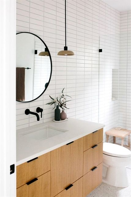 scandinavian bathroom with subway tile and round vanity mirror rh pinterest com