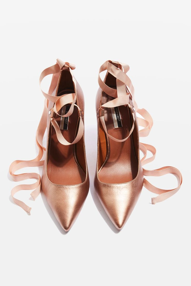 Complement your dress with a luxe pair of shoes for the party. These rose gold heeled court shoes come with ribbon detail for a tie-up look.
