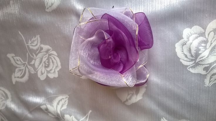 Made this rose flower - purple and white with a goldish line