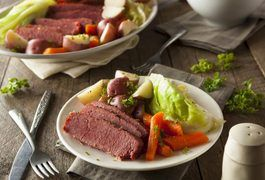 Approximately 34 percent of Americans make a special meal on St. Patrick's Day, and by far the most popular choice -- although it isn't authentically Irish -- is corned beef. Traditional corned beef recipes call for boiling the meat in a large stock pot along with vegetables like carrots, potatoes and cabbage. The editors at America's Test Kitchen,...