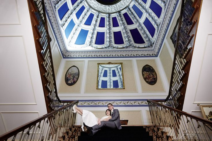 Wedding portrait on the iconic staircase of Shrigley Hall.