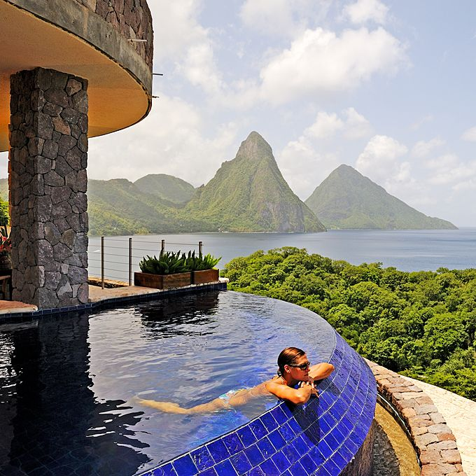 Brides.com: Top 10 Resorts in the Caribbean. Jade Mountain, St. Lucia    All but one of this resort's 29 rooms has one wall open—the better to take in those jaw-dropping Caribbean and Piton Mountain views. As if your whirlpool-for-two weren't sexy enough, most also have a private infinity pool overlooking the endless azure sea; Jade Mountain.