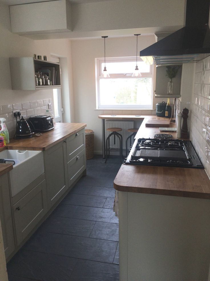 Howdens Burford Grey kitchen. Metro tile.