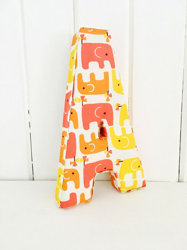 A personal favourite from my Etsy shop https://www.etsy.com/uk/listing/523301416/red-yellow-elephant-nursery-decoration