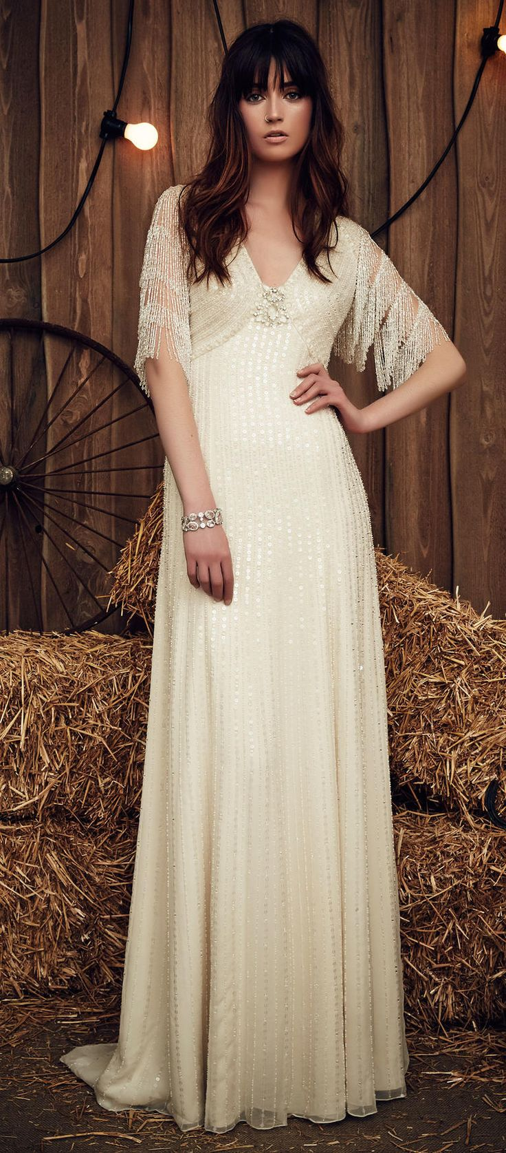 Jenny Packham Spring 2017 Savannah off-white wedding dress with flapper-inspired, beaded sleeves, v-neck, and drop-waist skirt covered in off-white sequins
