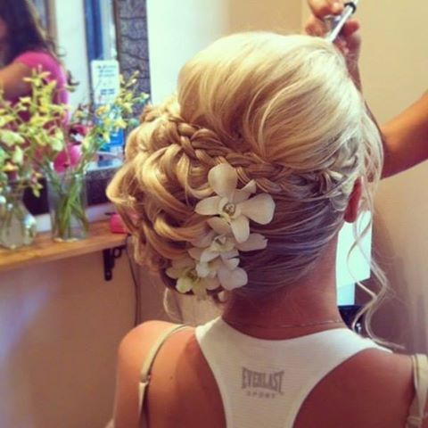 Gorgeous bridal updo! Without the flowers though and the bun centered