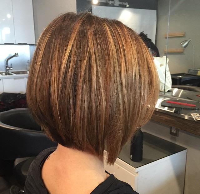 Another beautiful job done by our stylist, Alix! This sophisticated and chic bob was perfected with caramel highlights that blends into her light brown base creating a warm tone that is a great look for fall! Call us today to book an appointment with one of our educated and talented stylists.