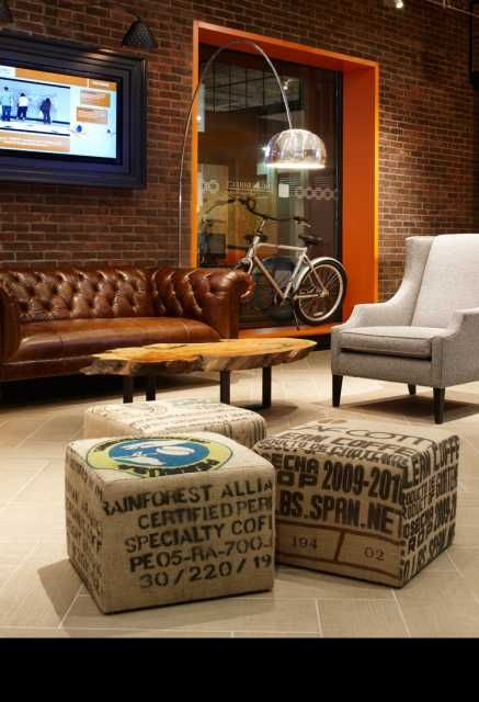 Our Upcycled Ottomans are a fun addition to the ING Direct Cafe designed by II by IV