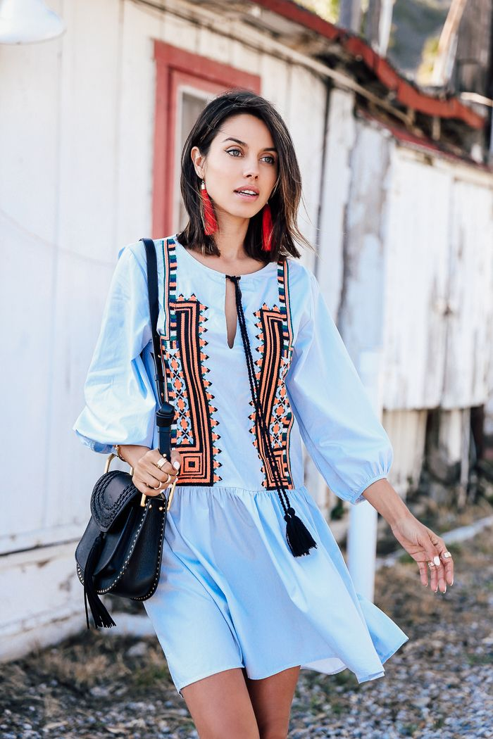 Annabelle Fleur in a worldly bue embroidered cotton dress from our Spring Fashion collection. | H&M OOTD