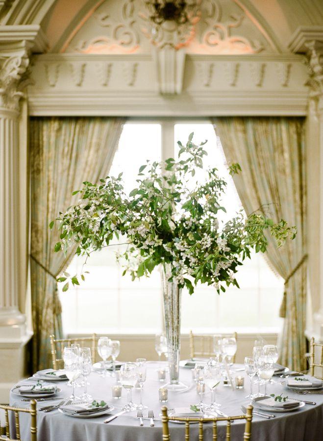 Modern organic eucalyptus centerpieces: http://www.stylemepretty.com/2016/10/27/classic-ashford-estate-wedding/ Photography: Rebecca Yale - http://rebeccayalephotography.com/
