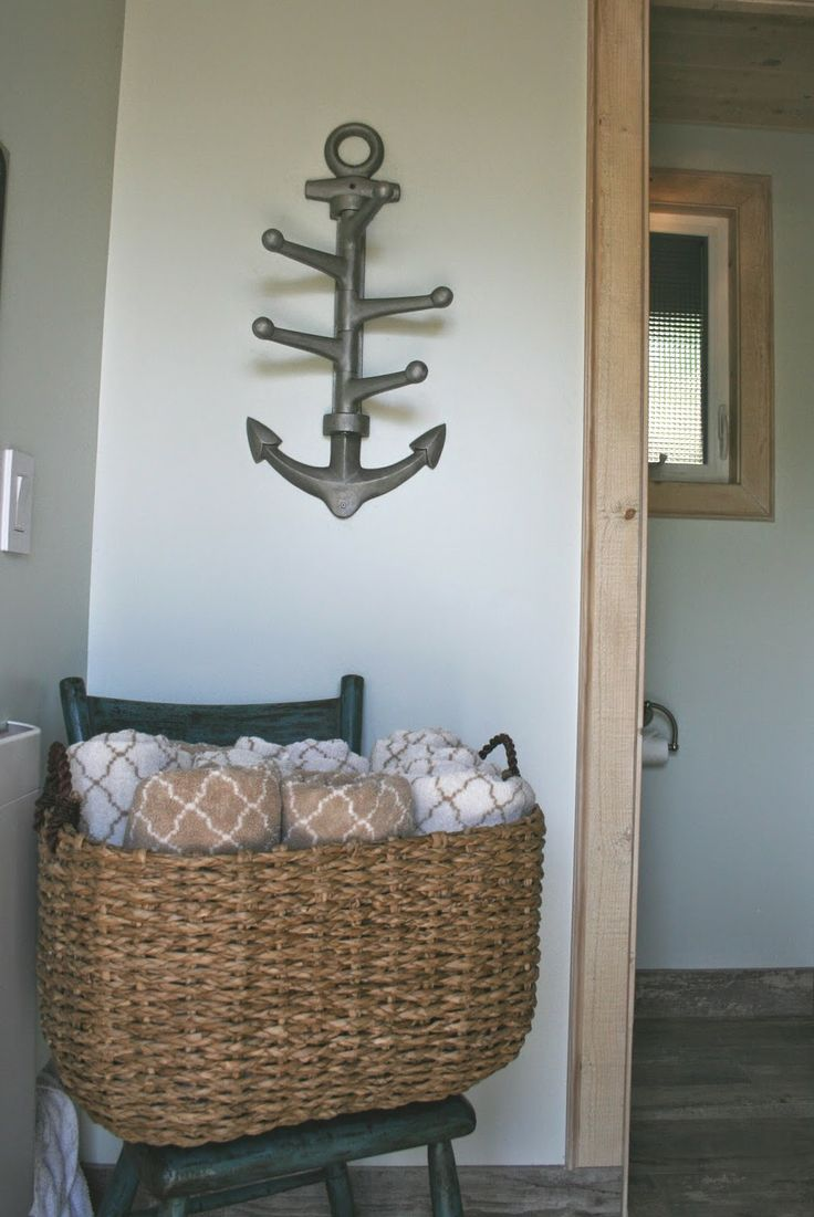 Towels are on-hand in this pretty basket as you enter. After your sauna, hang your towel on this fun Pottery Barn anchor hook!