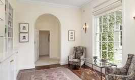 The Hallway entrance to the light and airy sitting area opposite the library wall