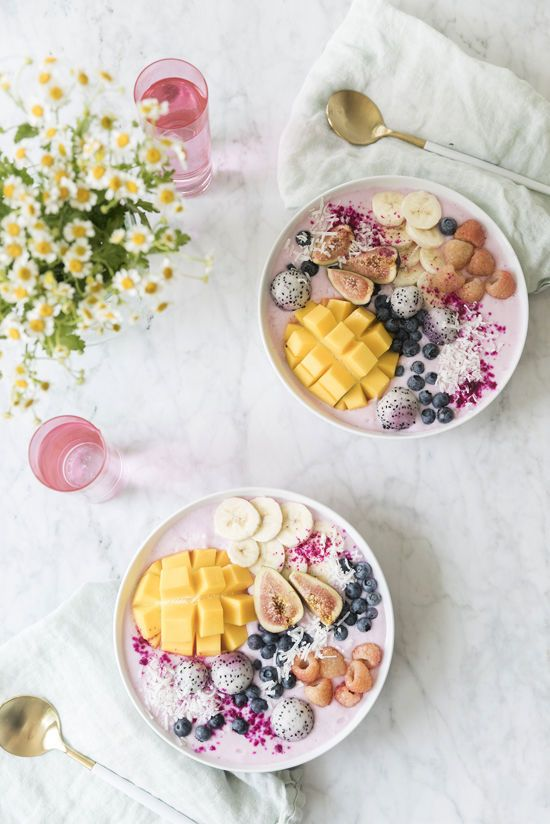 beautiful smoothie bowls topped with fresh fruit