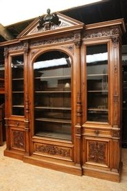 Exceptional monumental walnut renaissance bookcase with bronze statue of Doctor Pinard