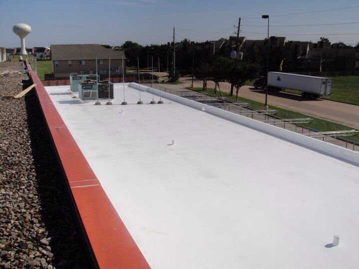 180000 sq ft firestone tpo retrofit system over r panel metal roof