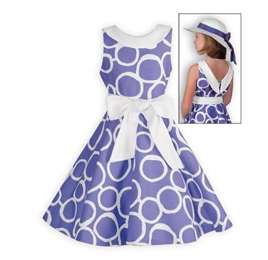 Shell love to twirl in this fun and stylish swing dress with full circle skirt. White circles printed on purple 100% cotton with linen finish. Remova