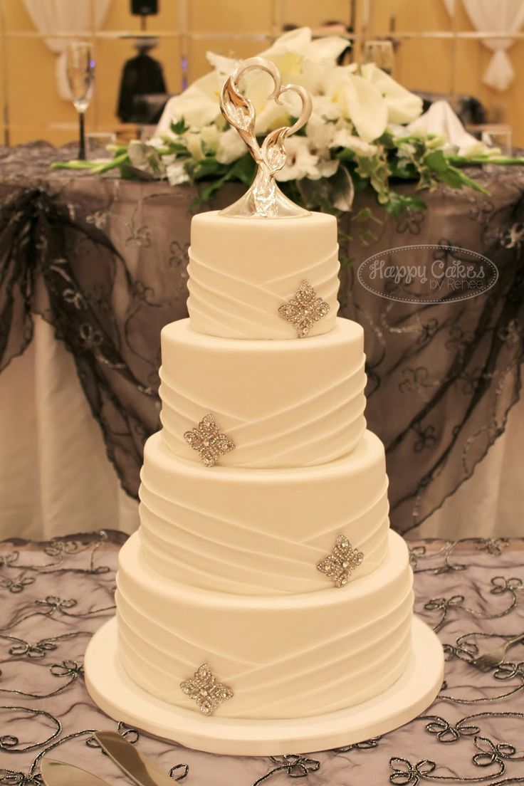 Diagonal pattern wedding cake. Change jewels to blue iced flower.