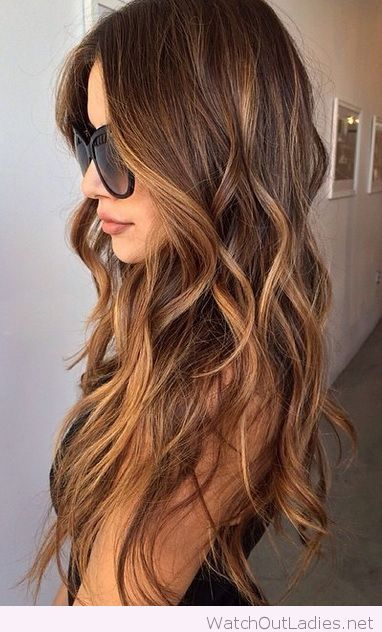 Lovely curly brunette locks with sultry caramel highlights