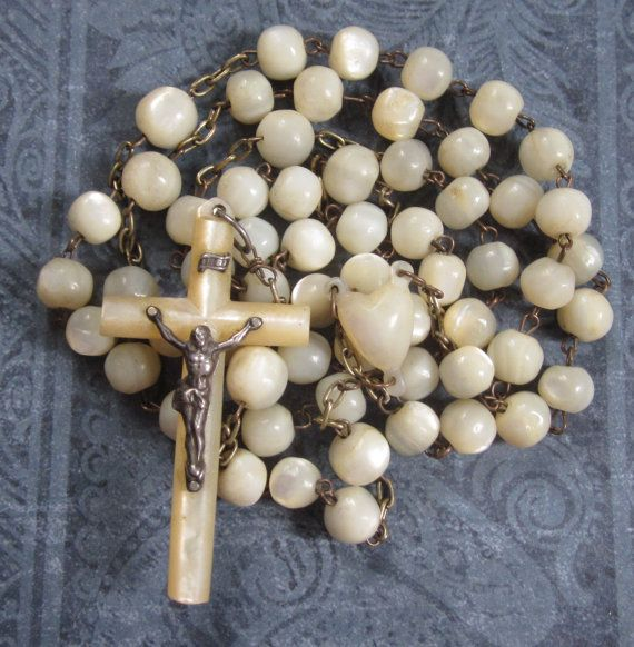 antique mother of pearl rosary..I have an 18kt gold one with mother of pearl similar to this one. I treasure it...