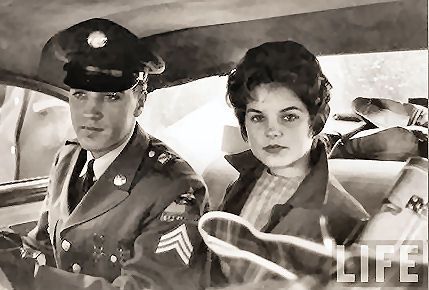 Elvis and Priscilla on the way to the airport, March 2, 1960